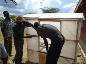 Participants are trained on how to make a Drier